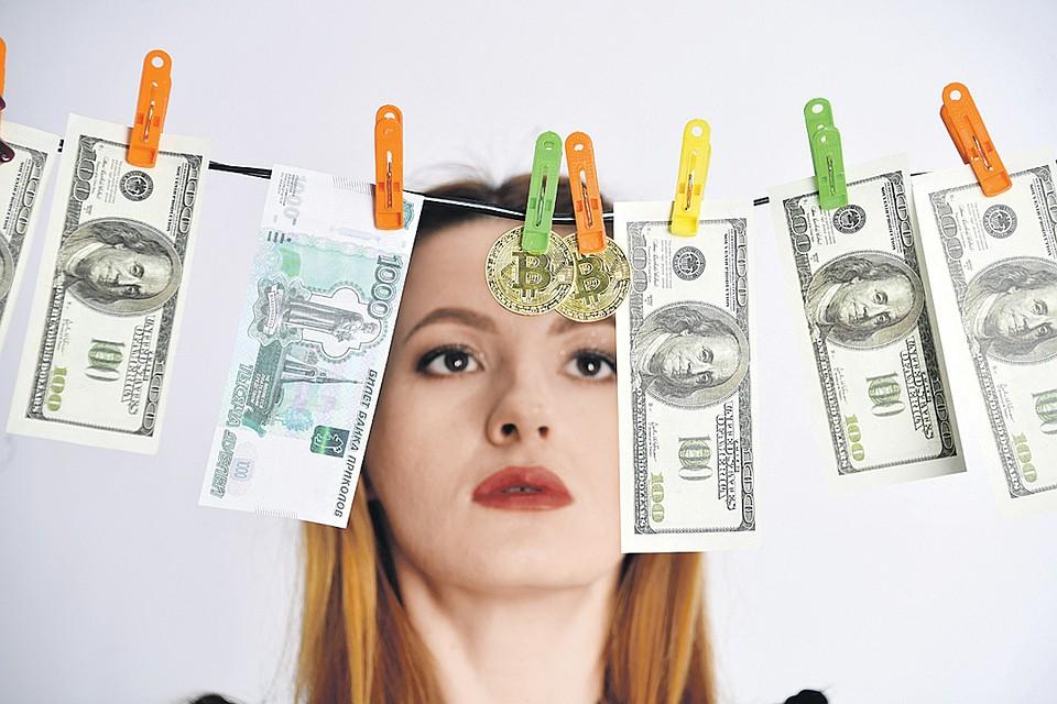 Биткоины часто изображают в виде монеток, но на самом деле это виртуальные деньги.