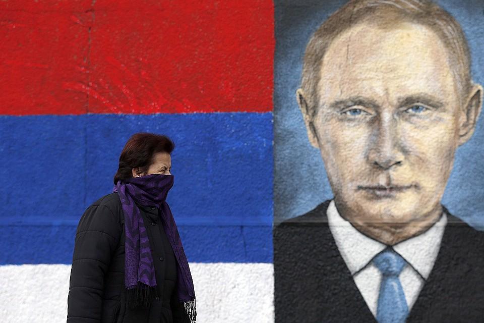 Уличный рисунок с портретом российского президента в центре Белграда.