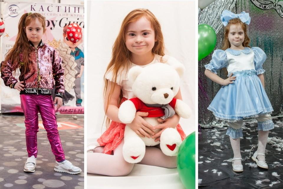 Девочка мечтает стать моделью.