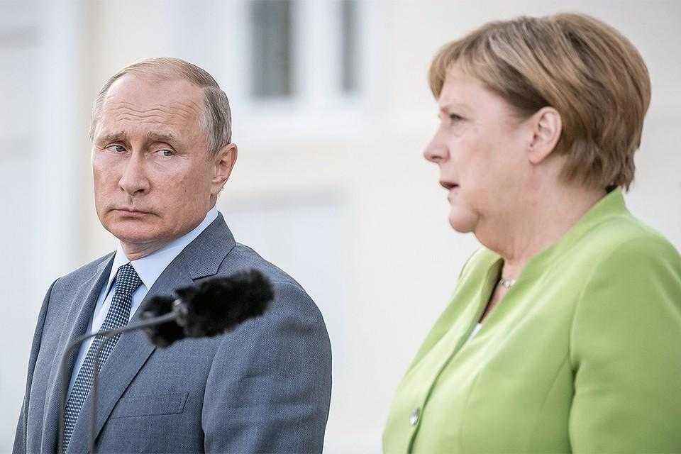 Владимир Путин и Ангела Меркель во время переговоров в Германии, 2018 г.