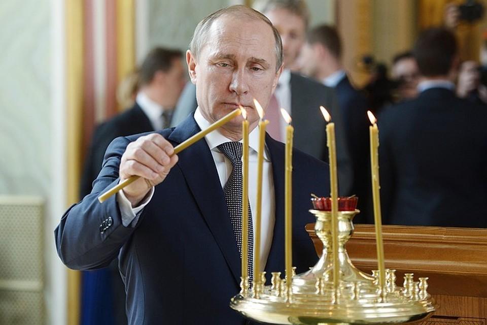 Владимир Путин на рождественском богослужении. Фото: Алексей Никольский/пресс-служба президента РФ/ТАСС
