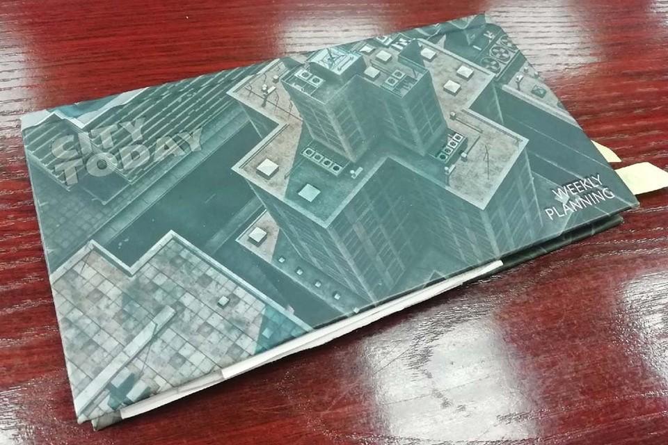 Сим-карты спрятали в блокнот