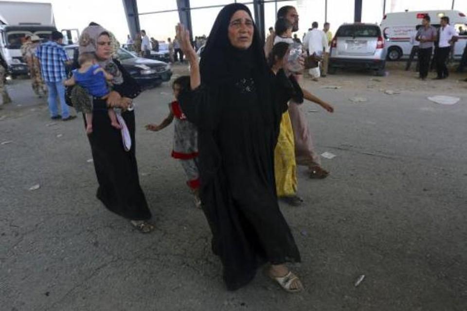 Люди бегут из захваченного боевиками Мосула