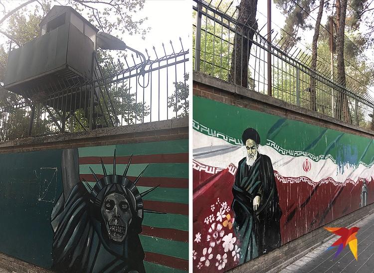 Стены бывшего посольства изрисованы революционным граффити. Справа – аятолла Хомейни, духовный лидер иранской исламской революции