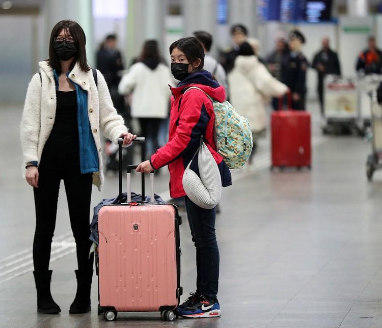"""Китайские туристы в аэропорту """"Шереметьево"""". Фото: Михаил Терещенко/ТАСС"""