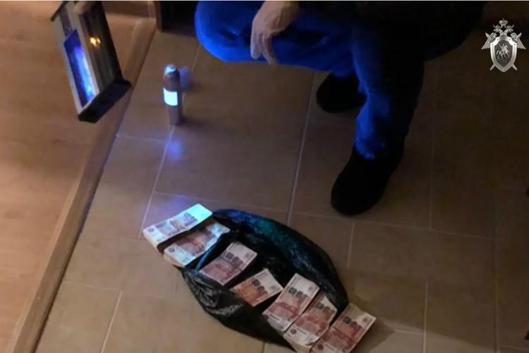 Те самые деньги, что получал Плитко в момент задержания. Фото: скриншот с видео СУ СКР по Кировской области