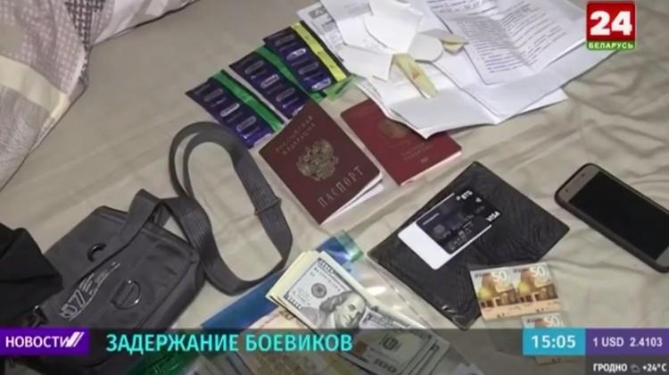 Документы и деньги задержанных. Кадры из репортажа белорусского ТВ