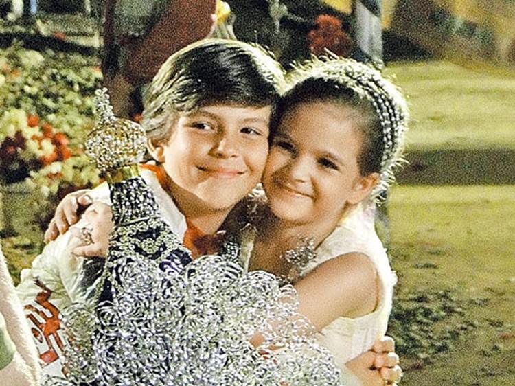 Рита (она же Нина) и Жоржиньо в детстве.